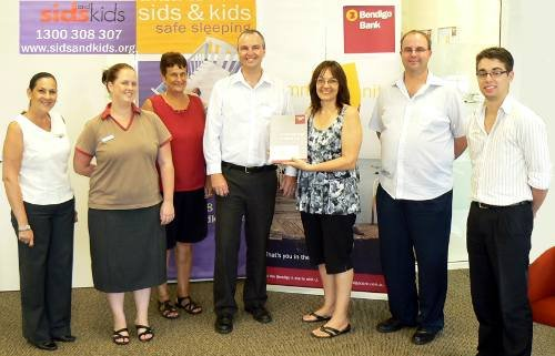 Branch Manager Jeff Watson presented SIDS 4 Kids NT with a donation.